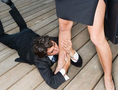 Businessman Kissing Businesswoman's Leg